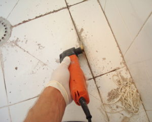 Tile grout removing and regrouting