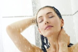 woman having shower after resealing